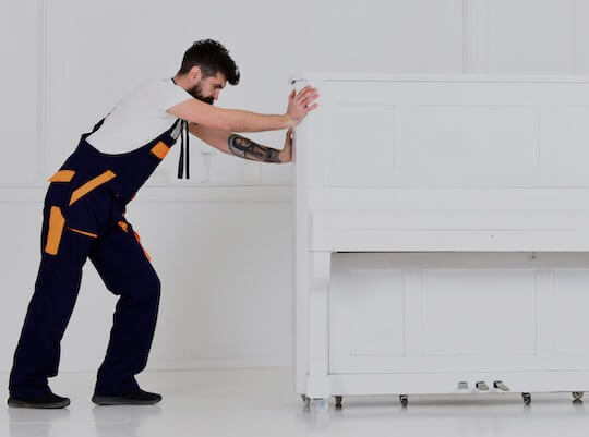man performing a piano removal service