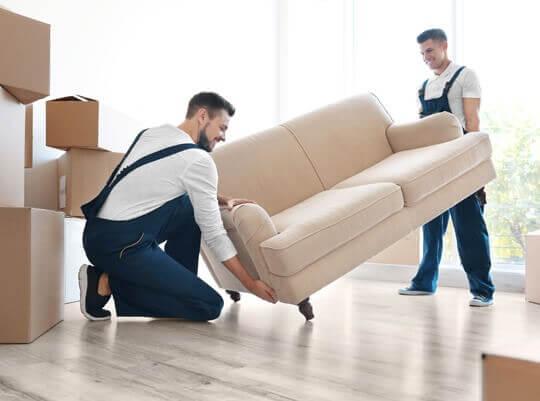 men unloading furniture from a van