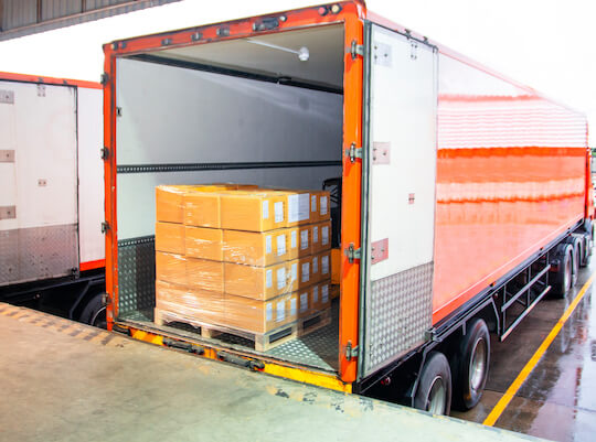 freight being loaded up to be shipped