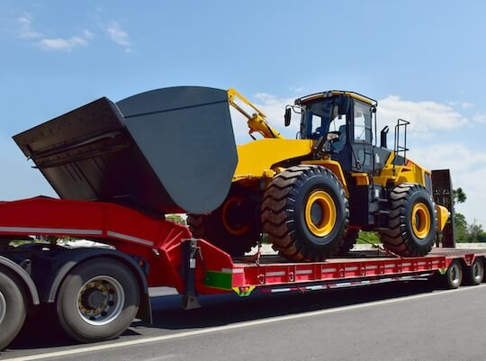 heavy equipment being transported on the motorway