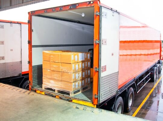 truck being loaded with freight for shipping